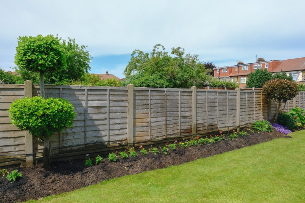 Garden fence with freshly planted flower bed, JJO Fencing and Gardening Services Ltd, Fencing, Hedge Trimming, Fencing Suppliers, Fence Company, Grass Cutting, Warminster, Westbury, Frome